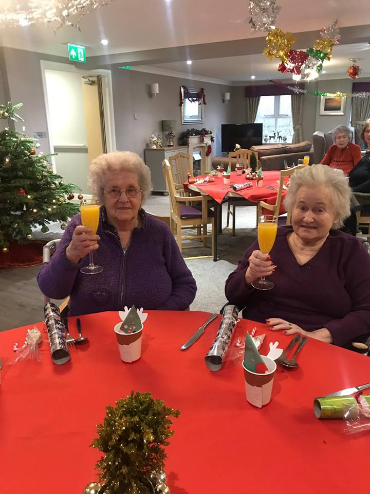 Doreen and Trudy toasting to another merry Christmas at Magnolia House