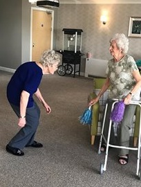 Pam and Betty dancing at a recent party